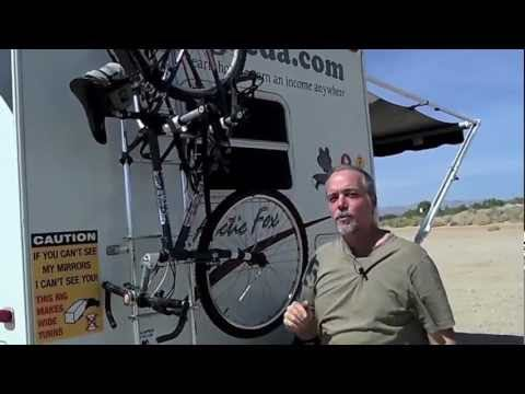 RV bicycle rack uses roof ladder to transport bikes