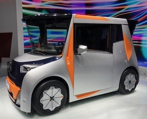 Mini electric car doubles as office, living space
