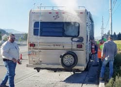 Nearby drivers help fifth-wheel owner douse flames