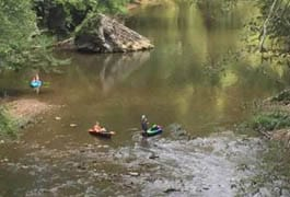 Three female kayakers found after spending night on a rock