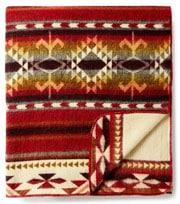 Handwoven Ecuadorian blankets make a vibrantly colorful accessory