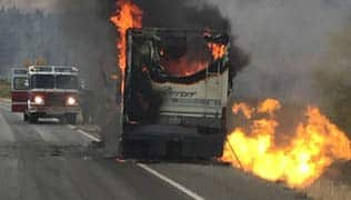 Firefighters can't save burning motorhome on Washington highway