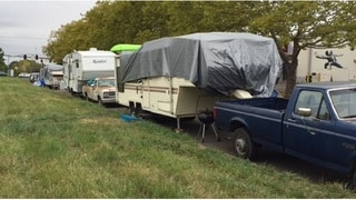 Oregon city to allow regulated car camping in specified parking lots