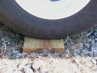 Tire ramps or blocks may damage your tires