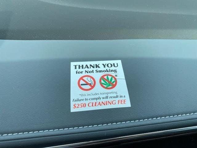 A new warning sticker on rental vehicles prohibiting smoking pot.