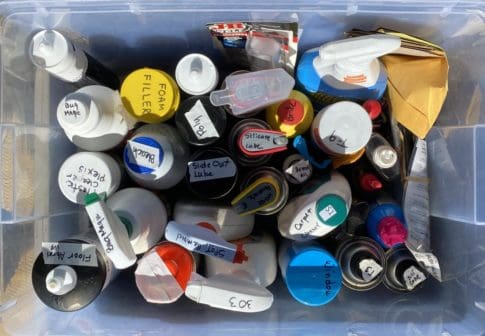 storage bin with assorted cans, bottles