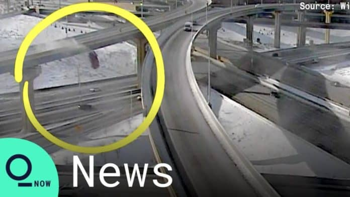 The driver a pickup truck drove his truck ovver a freeway barrier and fell 70 feet has bee cited with several offenses.
