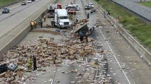 A truck accident resulted in a highway full of frozen pizzas.