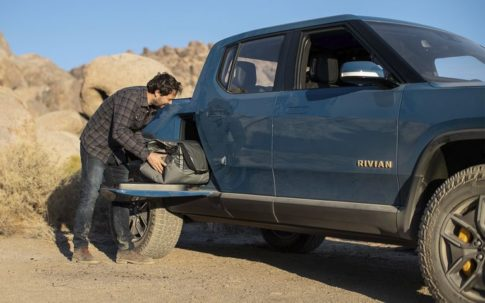 The Rivian pickup truck will include a mid-truck storage area.